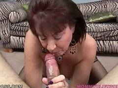Older hooker enjoys the taste of partner`s erect cock.